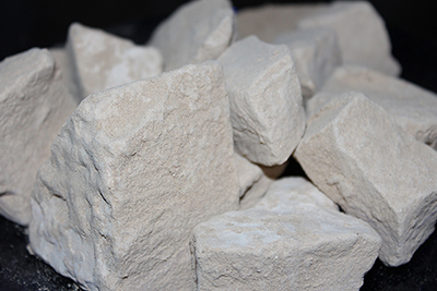 Caliche clay chalk chunks. Caliche is a desert clay dirt that is hard when dry, and a powdery chalk