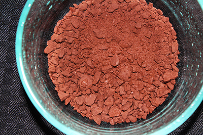 This edible reddish brown clay in mined from a mountain wall.