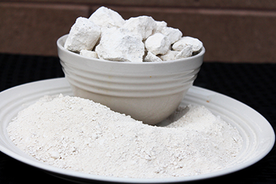 Gritty white clay that is edible and has giant pieces.