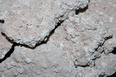 Crumbly white clay that has a rainy taste of kaolin mine wall washes from the rains.